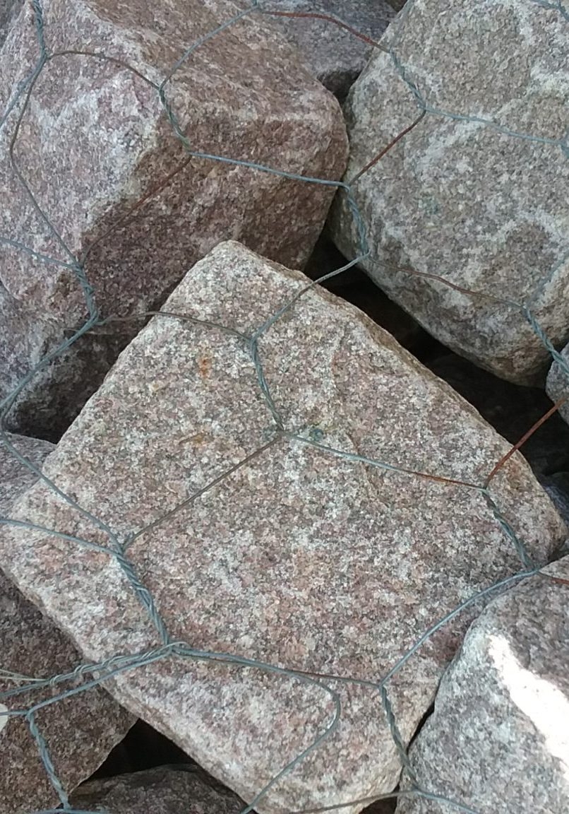 Pink Granite Cobbles At GrassMasters Landscaping